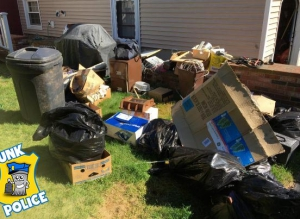 junk items all over yard for junk police to cleanout