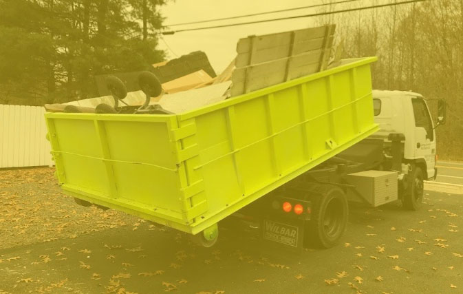 Dumpster truck with a loaded dumpster